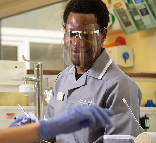 Male in uniform in dental surgery room