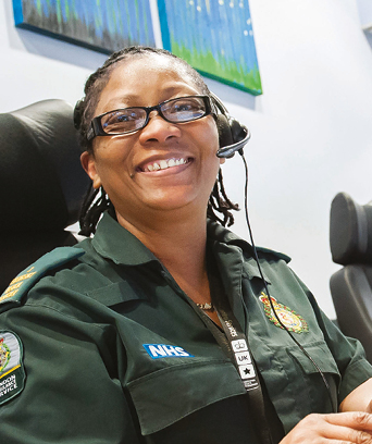 Female in uniform sitting in ambulance control room