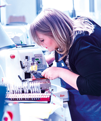 Female technologist working with samples
