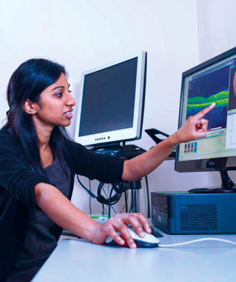 Female pointing to computer screen showing graph