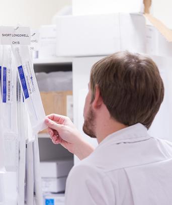 Male technician checking equipment