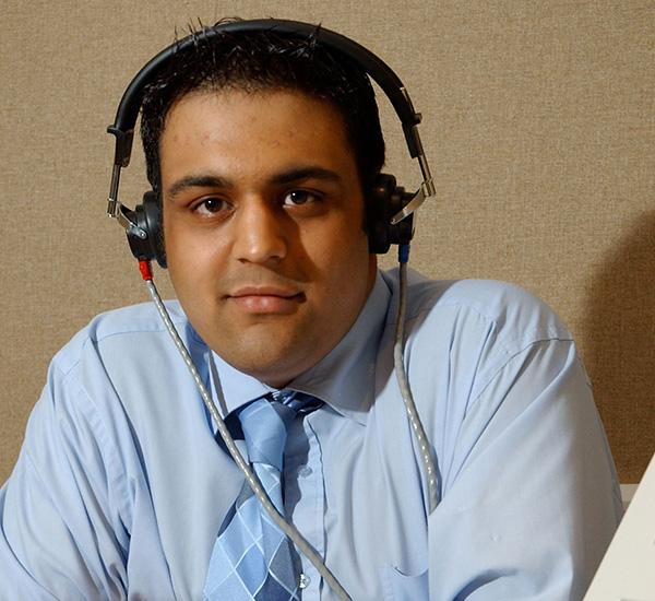 Male audiologist wearing headphones