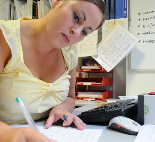Female at desk writing