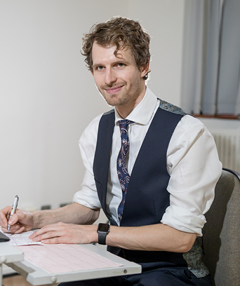 Male psychologist writing at desk