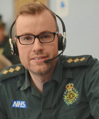 Male in uniform wearing headset