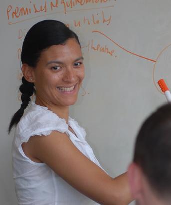 Female writing on whiteboard