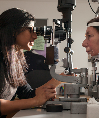 Female orthoptist conducting an eye exam